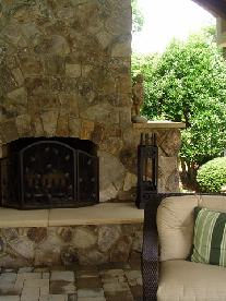 stone vaneer wood bruning fireplace with sandstone hearth and shoulders