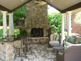 natural stone fireplace with sandstone hearth and shoulders