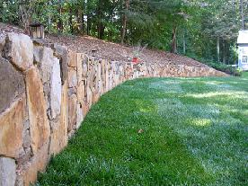stone retaining wall helps reclaim yard space