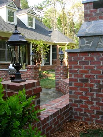 brick columns with carriage lighting