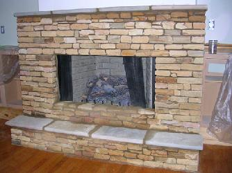 natural stacked stone with stone hearth and mantle