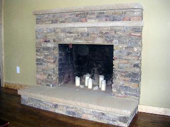 natural stacked stone fireplace with sandstone hearth