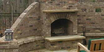 brick fireplace with privacy wall and bench