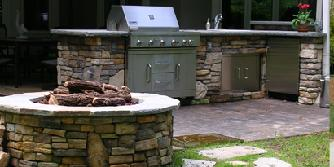 outdoor kitchen with gas log firepit