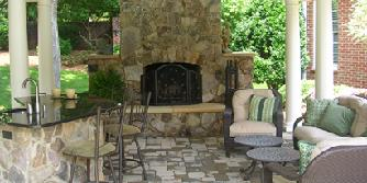 stone fireplace with sandstone hearh and mantle