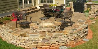 stone fire pit with sitting bench