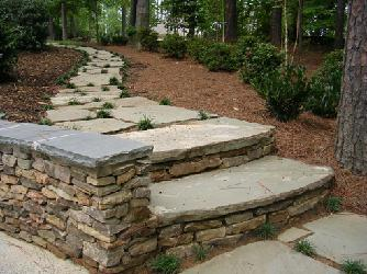 natural stone steps with wall and stepping stones