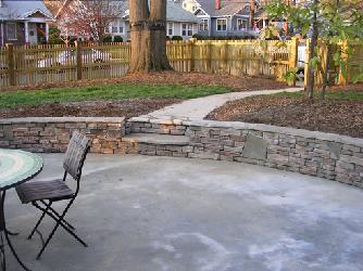 cultured stone retaining wall with steps