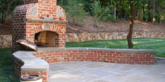 brick fireplace with bluestone patio and accents