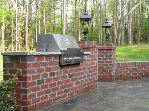 brick grill surround with bluestone counter top