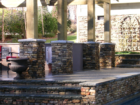 stacked stone columns with bluestone caps