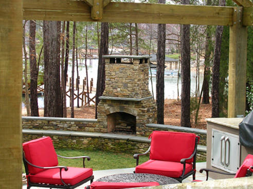 stacked stone fireplace with bluestone benches and mantle