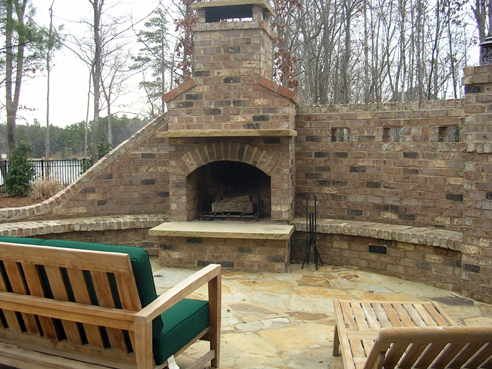 brick fireplace with sandstone hearth and mantle
