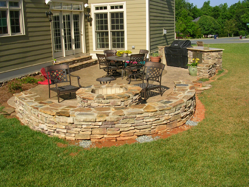 outdoor living area with gas starting fire pit