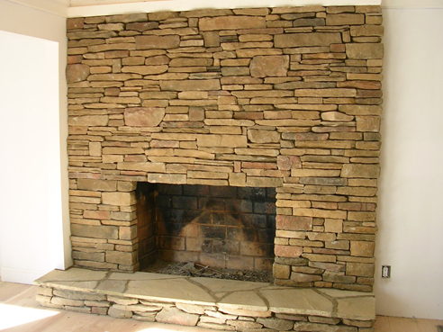 cultured stone floor to celing fireplace